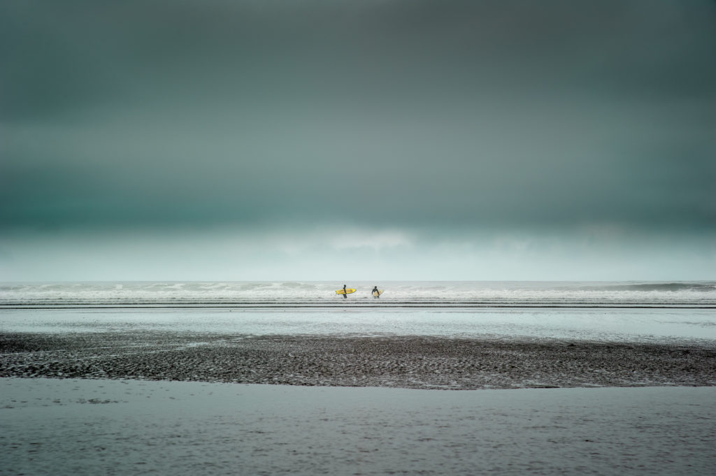 "2nd place, Waterscapes category: ""Two Surfers"" by Shuwen Lisa Wu"